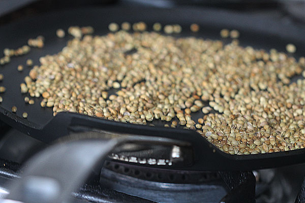 Roasting coriander seeds for garam masala