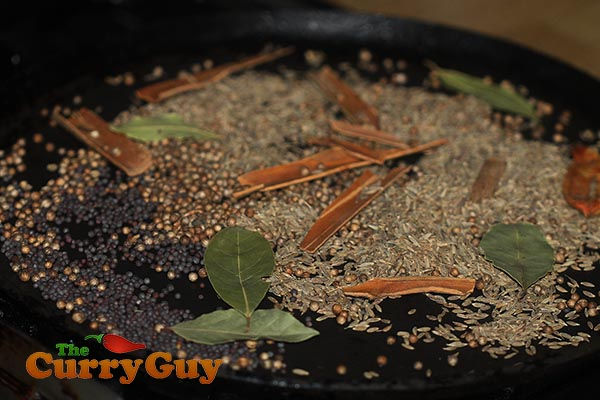 Roasting spices.