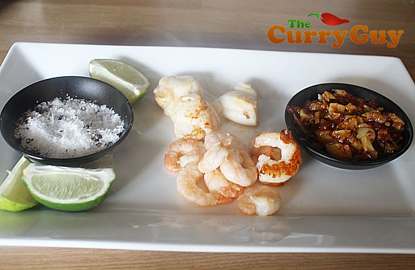 Quick Fried Prawns And Scallops Served With Garlic Confit And Limes