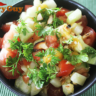 A Mango Salad With Tomato, Cucumber, Lime And Chillies
