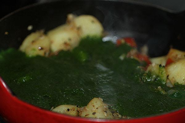 Making saag aloo