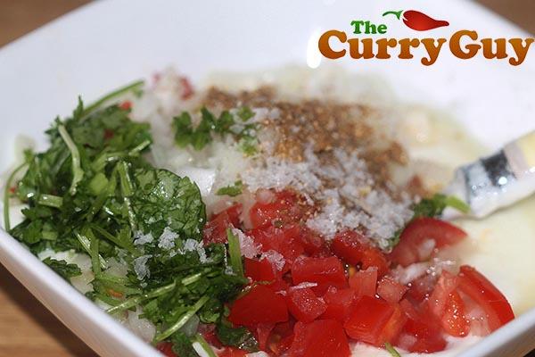 Making tomato raita