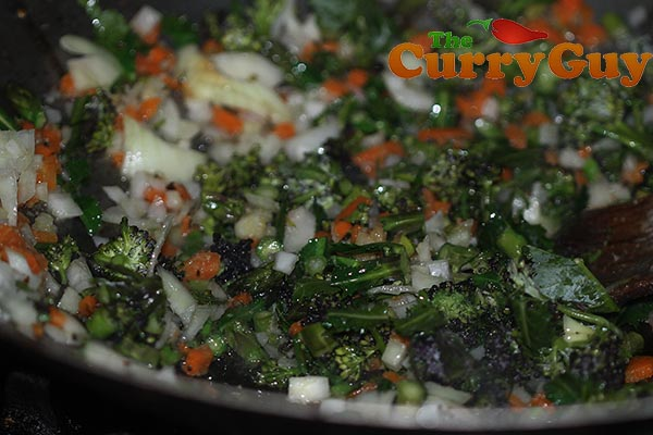 Making vegetable fried rice.