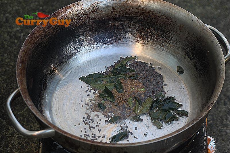 Making salmon curry