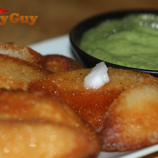 These fried idlis with coconut butter are so good dipped in a spicy coriander and chilli raita.