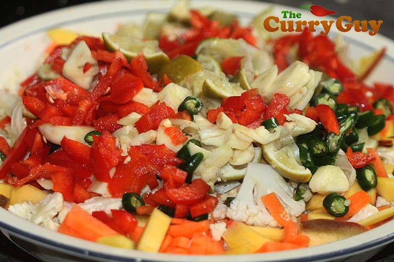 Making spicy mixed vegetable pickle