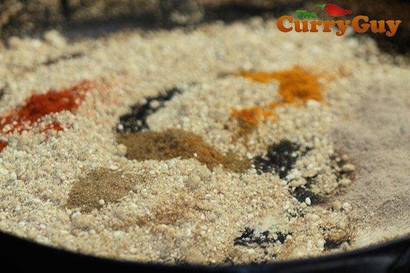 Making stuffed long green chillies