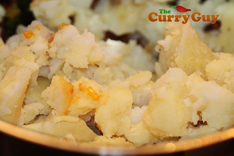Making potato curry
