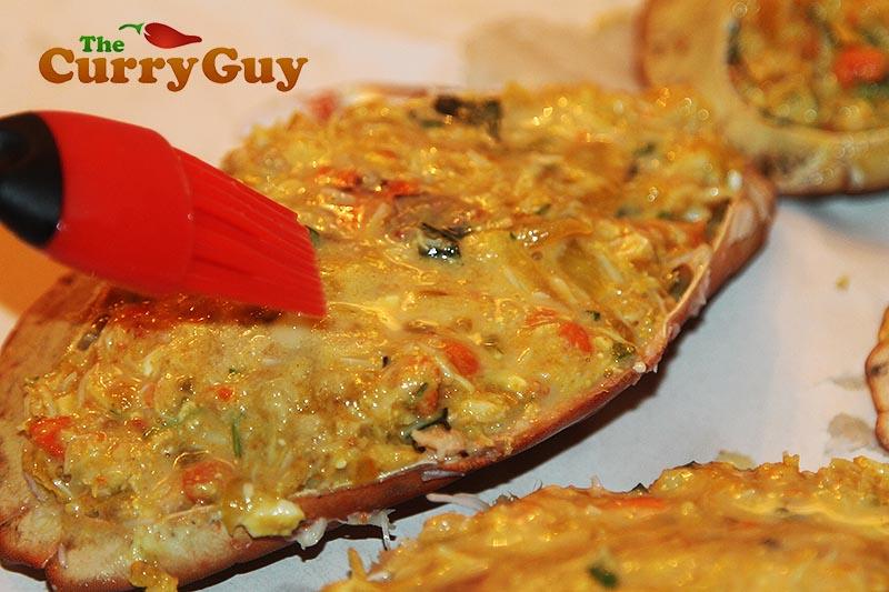 Making Masala stuffed crabs